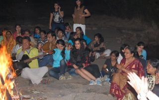 Youth Camp around Campfire at Ecomantra Experiential Eco Camps & Resorts